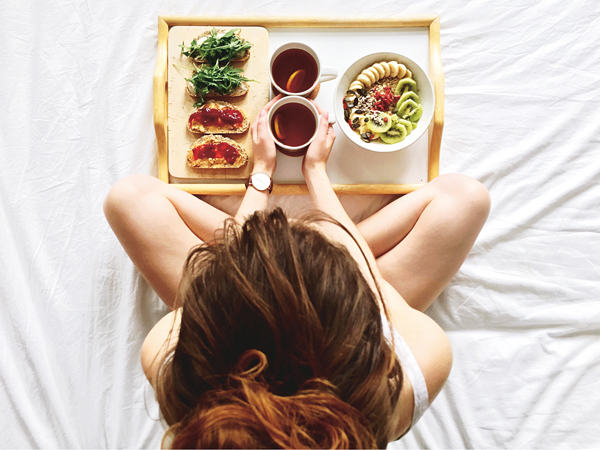 Directly Above Shot Of Woman Having Breakfast On Bed