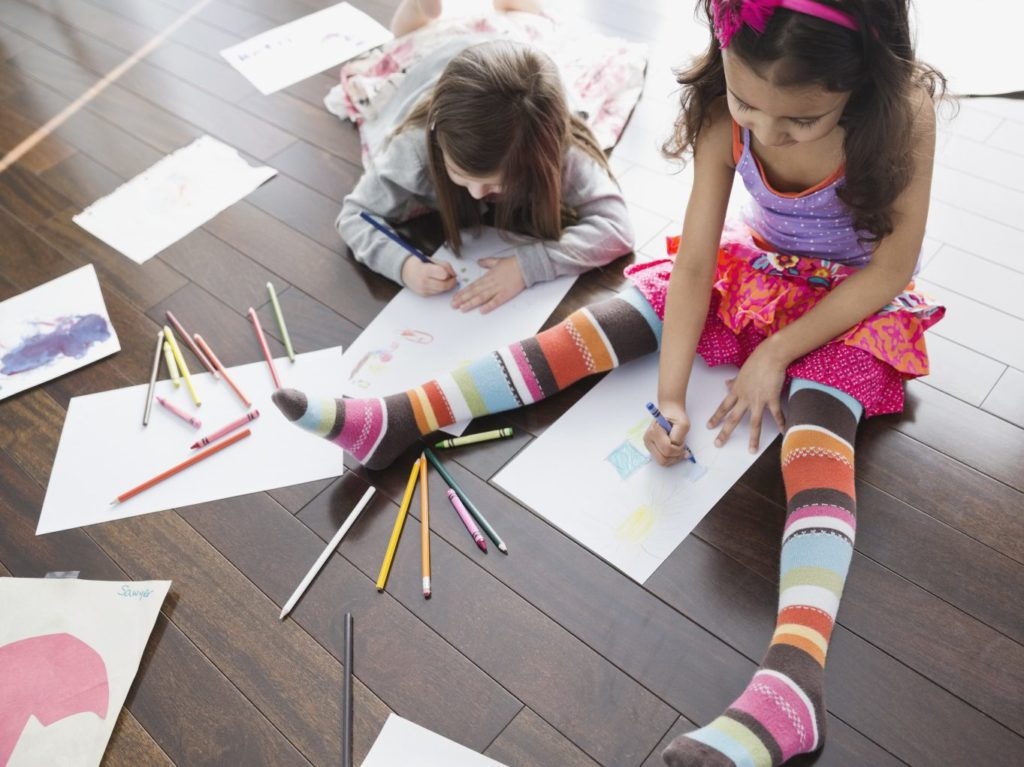 High angle view of girls coloring at home