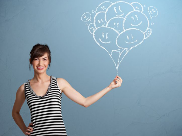 18529971 - happy young woman holding smiling balloons drawing