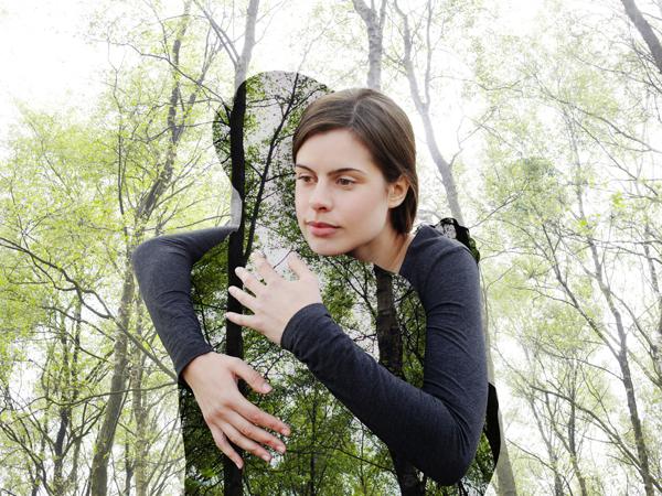 Woman hugging the environment.