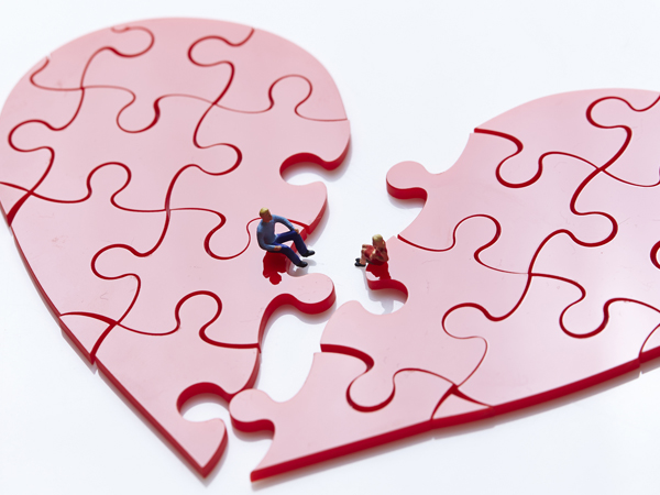 Heart shaped jigsaw puzzle with man and woman