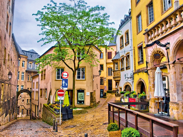 51280717 - luxembourg city, luxembourg - jun 2013: narrow medieval street with cafes on june 9, 2013 in luxembourg city, luxembourg