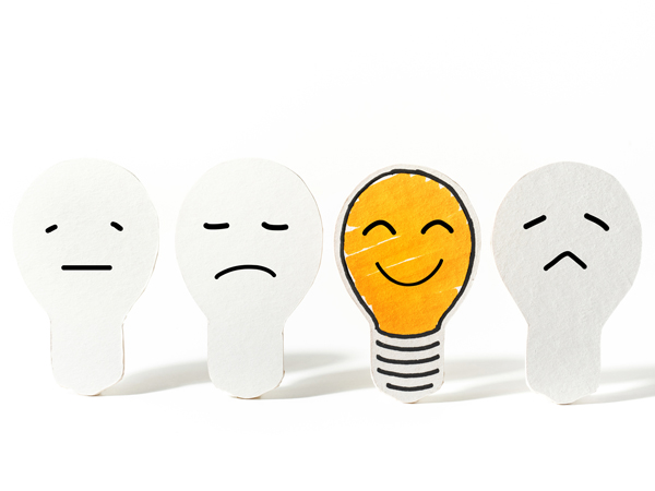 Light bulbs paper cut with emoticon face.Business ideas concept