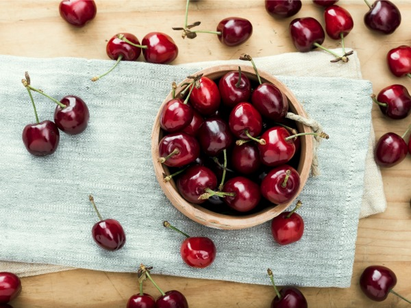 Fresh organic cherries on wooden background