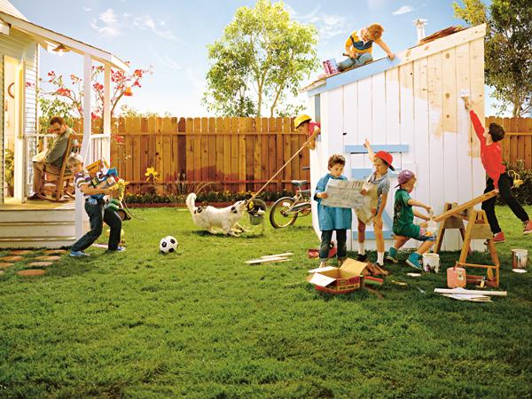 Group of boys building a playhouse