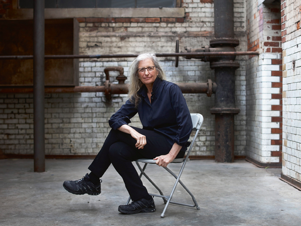 Annie Leibovitz, portrait photographer, poses for a photograph at the launch of WOMEN: New Portraits exhibition at Wapping Hydraulic Power Station in London, U.K., on Wednesday, Jan. 13, 2016. The international touring exhibition, commissioned by UBS, will be in London from Jan. 16 until Feb. 7. Photographer: Simon Dawson/Bloomberg via Getty Images