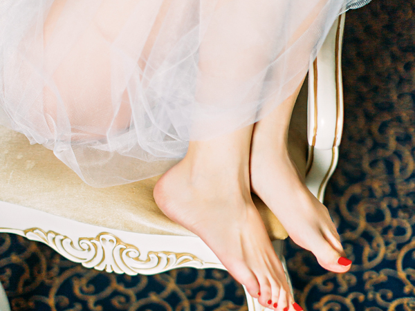 Beautiful brides legs  with bright pedicure close up; Shutterstock ID 1055427791; PO: -; Job: -; Client: -; Other: -