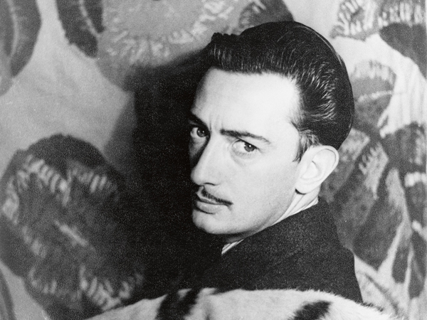Portrait of Salvador Dali - 1939. INCREDIBLE black and white images of 20th century artist Salvador Dali have been released on what would have been his one-hundred-and-thirteenth birthday. Pictures show a flamboyant, moustachioed Dali standing next to fellow surrealist artist, Man Ray in Paris in 1934, posing with a carved wooden black head against his face and another of the cat-loving artist and his beloved ocelot cat called Babou, who accompanied him everywhere he went. Another monochrome photograph depicts the Dali Atomicus, which shows the artist suspending in the air whilst cats and water fly across the foreground. Others show the Dream of Venus pavilion Dali designed for the New York World's Fair in 1939., Image: 331939036, License: Rights-managed, Restrictions: , Model Release: no, Credit line: Profimedia, Media Drum World