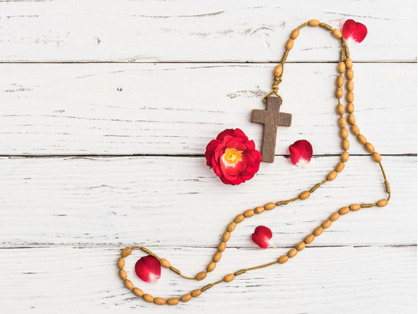 Background for obituary, mourning or condolence card with rosary cross and copy space