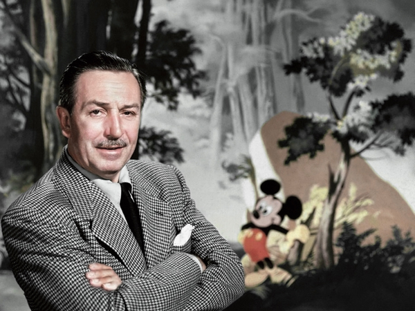 Entrepreneur Walt Disney poses for a portrait with Mickey Mouse in the background in circa 1955. (Photo by Donaldson Collection/Getty Images)