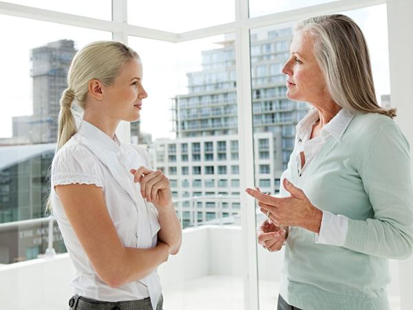 Two businesswomen talking in office