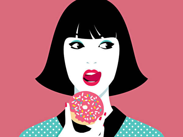 Young woman eating donut against pink background