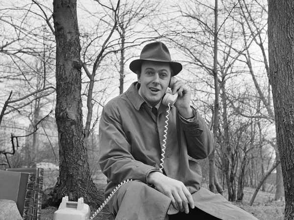 """Roald Dahl answers a telephone while filming an episode of the science fiction show """"Way Out"""" in Central Park, New York, March 25, 1961. (Photo by CBS Photo Archive/Getty Images)"""