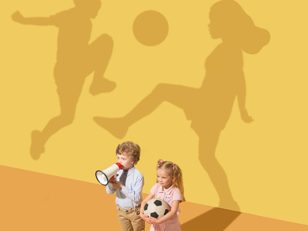 A true play without the rules. Pure emotions. Childhood and dream concept. Conceptual image with child and shadow on the yellow studio wall. Little boy and girl want to play football together.